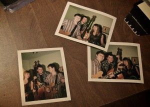 Polaroid Pictures of The Lonesome Hereos on a desk